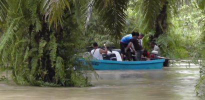 Foreign divers rescued after pickup swept into canal